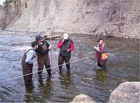 Technicians training and measuring water flows in Pine Creek.