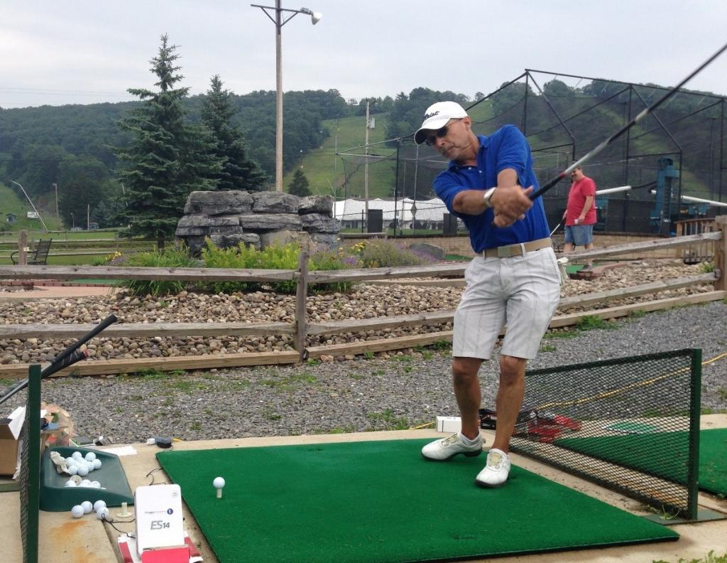 One of the experiment's golfers, Ben Farrell, at the tee driving his ball as part of an experimental run.