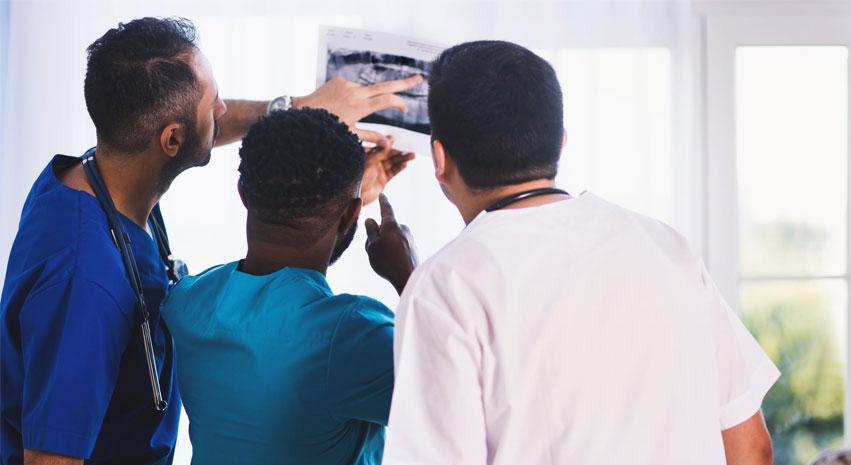 Clinicians examining a radiograph